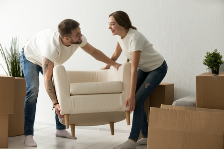 Stock Photo   Young Couple Carrying Chair Together, House Improvement,  Modern Furniture In New Home Concept, Man And Woman Moving Into Own Flat  After ...