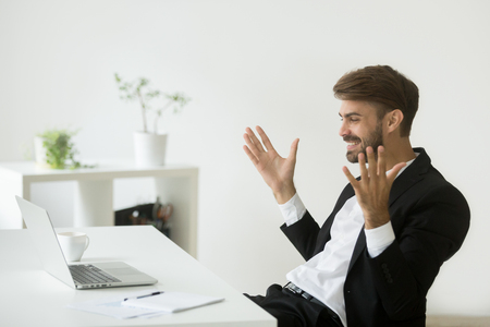 Glad company ceo satisfied with achievement looking at laptop screen, excited businessman in suit motivated by business win feels relieved figuring out online project result watching good news on pc 스톡 콘텐츠