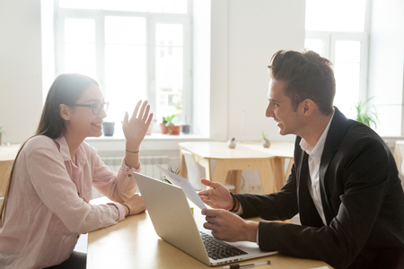 Hr and applicant laughing during successful job interview, happy vacancy candidate talking to smiling recruiter discussing winning resume making good first impression, recruitment and hiring concept Banco de Imagens