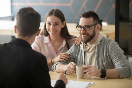 Realtor, bank worker, insurance broker or financial advisor consulting smiling millennial couple, happy clients customers planning mortgage investment, real estate rent purchase, taking loan concept