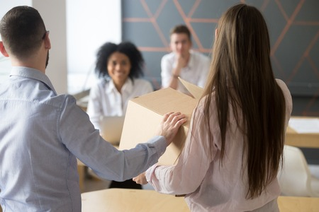 Team leader or company executive introducing new office employee introducing new office employee to colleagues friendly boss and coworkers welcoming just hired member joining team holding box on first day at work m4hsunfo
