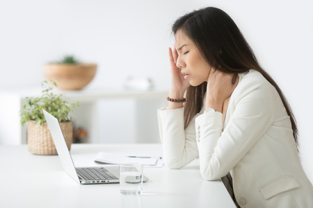 Stressed asian businesswoman having headache at work concept, frustrated dizzy chinese woman touching temple tired of aching head or chronic fatigue in office