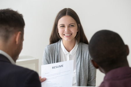 Happy smiling millennial applicant being interviewed by diverse hr managers Stock Photo - 101473027