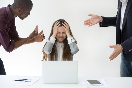 Angry overwhelmed businesswoman stressed about clients complaints or having headache holding head in hands