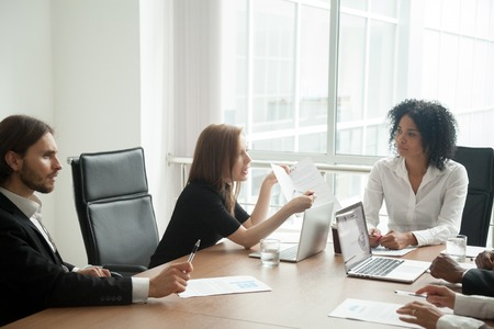 Deceived dissatisfied businesswoman having claims arguing about bad business contract terms Stock Photo