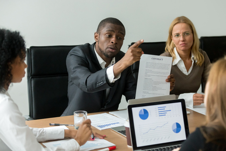 Angry dissatisfied african businessman having claims arguing about bad financial contract terms Stock Photo - 101472999