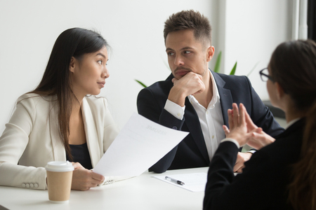 Colleagues thinking looking at each other discussing job applicant resume with female CEO, waiting for decision and thoughts. recruiting problem, reject, bad first impression, failed interview concept Stock Photo