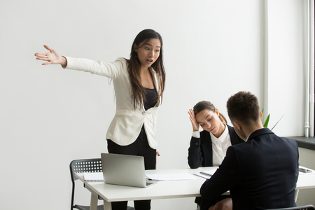 Angry mad HR manager pointing at door, making verbal sign for job applicant to leave. Work candidate showing no respect for employers. Concept of bad interview, disagreement, nervous workers