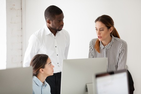 Serious multiracial team solving business problem together, diverse colleagues talking at workplace with computer, coworkers group discussing project focused on brainstorm or collaboration in office 스톡 콘텐츠 - 102258378