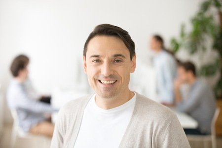 Successful smiling middle aged team leader looking at camera, confident happy businessman posing in office, business coach, ceo boss or professional executive company manager head shot portrait