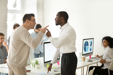 Multiracial african and caucasian colleagues disputing having disagreement at work blaming each other in mistake, diverse coworkers arguing about project, having conflict fight at workplace concept Stok Fotoğraf - 102258603