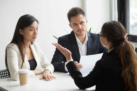 Skeptical unconvinced diverse hr managers interviewing female applicant feeling distrustful doubtful about rejecting vacancy candidate, failed job interview performance, bad first impression concept Stockfoto