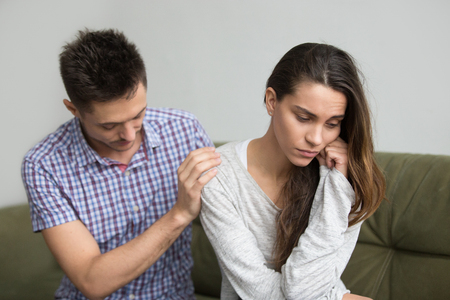 Caring husband supporting comforting upset wife getting depressed after miscarriage, boyfriend consoling sad grieving girlfriend feeling empathy, infertility diagnosis, sympathy in marriage concept