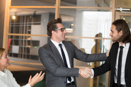 Smiling CEO shaking hand of male company worker congratulating with successful project, good job, getting contract, promotion. Boss laughing welcoming newcomer in business team, handshaking. Well done Stock Photo - 102621062