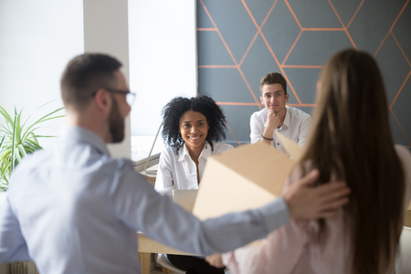 Excited multiracial colleagues welcoming newcomer in office, male boss introducing new employee at coworking space, get acquainted with diverse coworkers, newbie on first working day, introduction