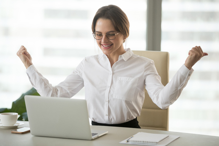 Excited female ceo witnessing company online breakthrough, happy businesswoman reading good corporate news of rates growing, confident boss watching market business success at laptop in office