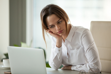 Thoughtful businesswoman thinking searching new ideas looking at laptop, serious employee feeling bored with dull monotonous online office work, employee disinterested in doing boring computer task Stock Photo - 107343967