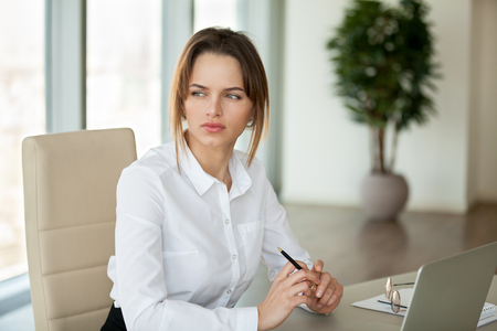 Thoughtful serious businesswoman thinking of business problem solution or planning new project working in office, pensive female writer looking away searching for inspiration feeling lack of ideas Stock Photo - 107343968