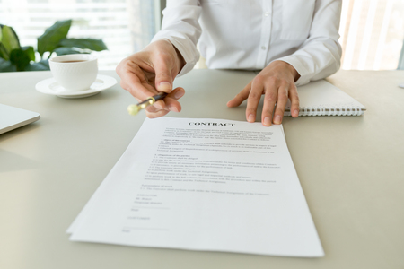 Woman gives pen offers to sign new job employment contract, partner promising good deal convincing to agree on terms of loan insurance put signature on legal business document concept, close up view Фото со стока