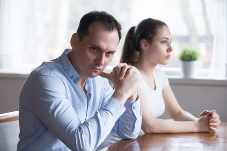 Stubborn couple avoid looking at each other after serious family fight, man and woman not talking sit separately having disagreement, spouses unwilling to communicate after conflict or argument