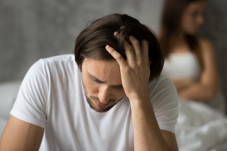 Close up of upset desperate man thinking about relationship problems, worried husband considering break up with beloved girlfriend after cheating, young spouses feel upset after fight or quarrel Stock Photo