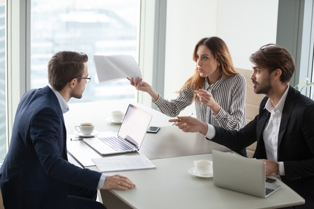 Diverse business partners disagree with company CEO on contract terms, people have dispute or fight at meeting in office, associates or colleagues argue at briefing failing cooperation or partnership Stockfoto