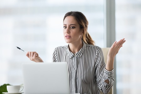 Confused businesswoman feel at loss looking at laptop screen with error message, frustrated female worker shocked by computer malfunction or online problem, seeing notice about pc crash or bad news Stock fotó
