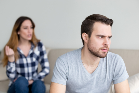 Annoyed husband tired of constant wife disagreement and lecturing, thoughtful man thinking about break up or separation with lover bothered by woman pressure. Relationships problem concept