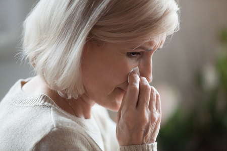 Sad senior middle aged woman widow mourning crying wiping tears, upset desperate old elderly mature lady weeping grieving lost love, having disease, suffering from depression grief divorce concept Stock Photo