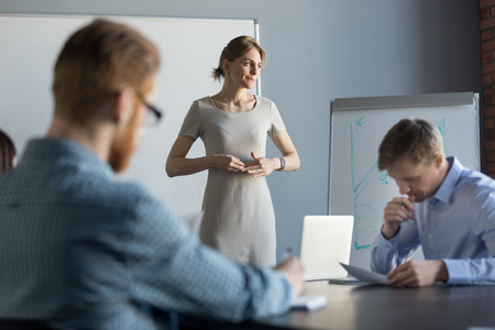 Stressed business woman leader executive in tension feels worried thinking of problem challenge at meeting, female speaker nervous about result waiting for clients decision after sales presentation 版權商用圖片
