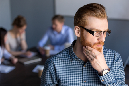 Serious thoughtful businessman in glasses looking away holding hand on chin planning project, considering new idea opportunity solution, thinking of future challenge at work, business vision concept Stock Photo