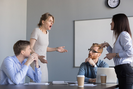 Business women colleagues disputing arguing at corporate office meeting, mad angry shocked female employee disagree with coworker blaming for bad work, conflict and rivalry at workplace concept