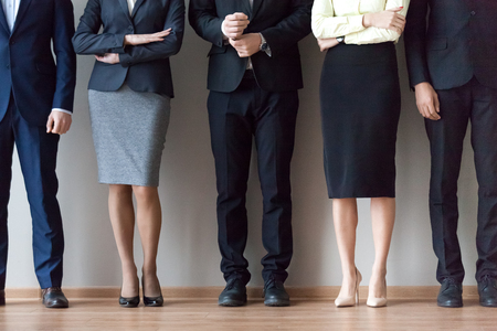 Legs of diverse work team pose for corporate photoshoot or make picture, job applicants in suits standing in row, waiting for recruiting talk or interview results. HR, hiring, employment concept Stock Photo - 109614847