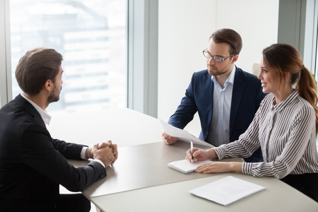 Two hr managers talking with candidate for vacancy. Job seeker at job interview answering questions of employer. Hiring, staff recruiting process. Stock Photo - 111159537