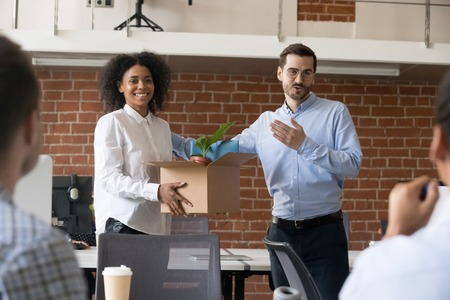 Friendly company ceo welcoming female african american employee introducing hired worker in multiracial office getting acquainted supporting new team member on first work day, introduction concept Stock Photo - 111160756