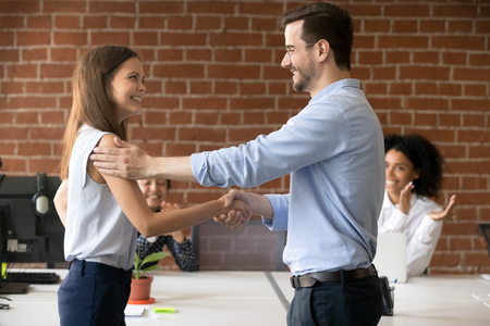 Happy boss handshaking successful employee congratulating with job promotion, appreciating for good work, encouraging rewarding, ceo intern shaking hands as concept of support recognition respect Фото со стока