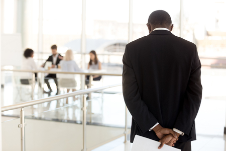 Nervous African American employee standing in hallway waiting to enter business meeting, worried black presenter anxious about making presentation for colleagues or workers in boardroom Stock Photo - 112479539