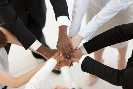 Diverse business people group put hands together in stack pile at training as concept of sales team corporate unity connection, teambuilding loyalty, support in teamwork, coaching, close up top view Stockfoto - 112485576