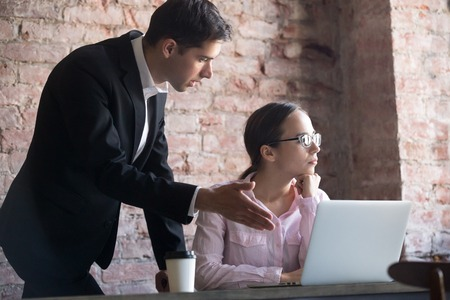 Team leader correcting offended employee at work. Mentor conflicts with student. Manager scolding worker for mistake or incompetence. Banco de Imagens