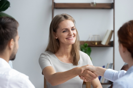 Attractive new employee newcomer shaking hands getting acquainted with staff during meeting. Coach greeting company owner starting training, investor and representative handshaking before negotiating Stock Photo - 114278064