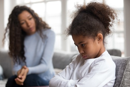 Mom or psychologist talking counseling upset offended african american child girl feels sad insulted, sulky frustrated black mixed race kid daughter having psychological trauma depression problem
