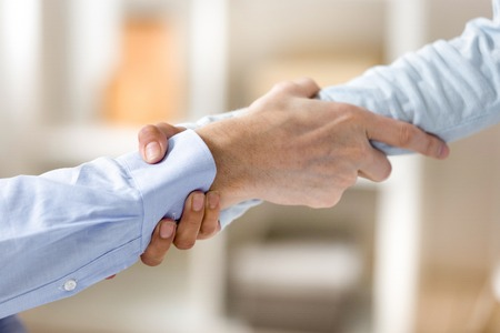 Close up man and woman holding each other wrists, hands, support in team, collaboration and unity concept, reliable business partners show strength and power, team building activity Stockfoto - 115435806