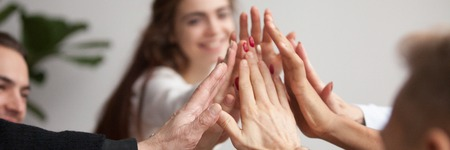 Horizontal close up photo young business team giving high five celebrate success join hands together feels happy, symbol of team spirit support teamwork unity concept, banner for website header design