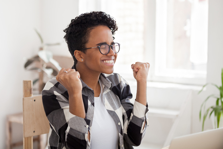 Excited black girl feeling winner celebrating great offer result opportunity, happy african woman motivated receive good news on laptop, intern worker hired promoted, get new job, college admission Stockfoto