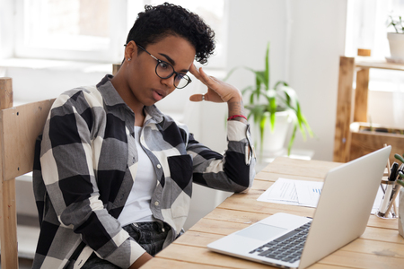Bored african woman tired from computer work study online feeling dull at workplace, unmotivated black young woman student disinterested in monotonous job routine, lack of new ideas or motivation