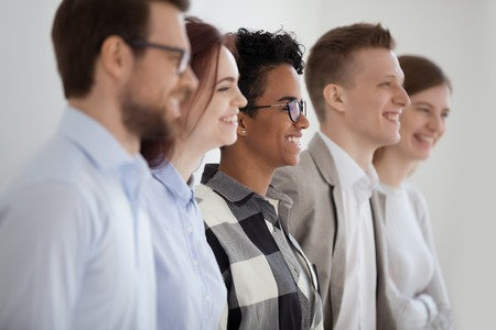 Multi ethnic happy business team people group profile side view, smiling diverse job seekers, professionals or office workers laughing standing in line row, human resources and recruiting concept