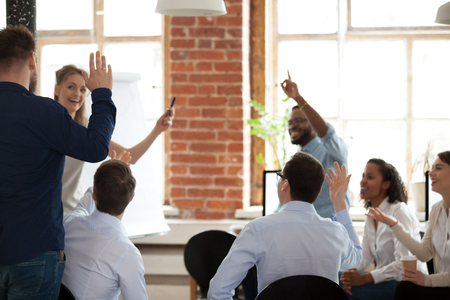 Business people raising hands up voting asking questions at corporate conference educational training, employees engaged in volunteering at group meeting, coaching, teambuilding activity concept Stockfoto - 116534160