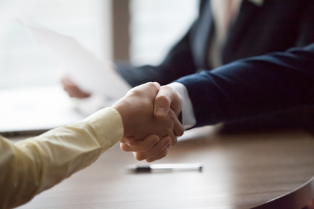 Close up view of businessman and businesswoman hands shake at meeting, respect concept, hiring employment handshake corporate partnership, greeting new partner express loyalty gratitude collaboration Stock Photo