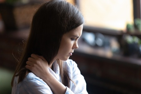 Close up face of young sad woman sitting alone feels lonely thinking about unrequited love has difficulties in relations with beloved one. Parent and teen misunderstandings teenagers problem concept Imagens