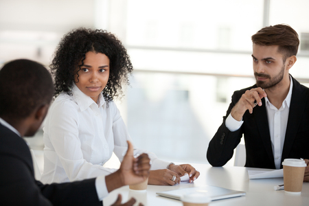 Diverse professional company staff sharing knowledge and ideas during seminar. Business people parties discuss an issue to finding a mutually acceptable solution negotiating sitting together in office Stock Photo